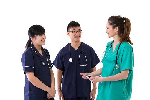 Portrait of three multi-ethnic doctor and nurses talking to each